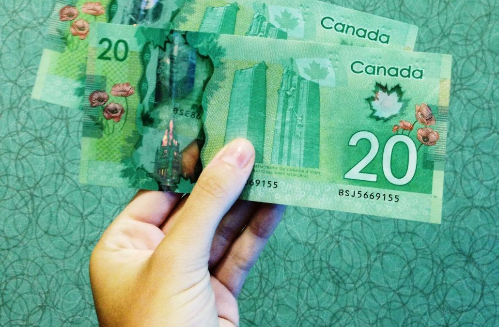 Hand Holding up Canadian Cash